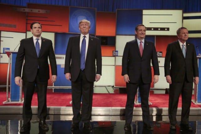 Les candidats à l'investiture républicaine Marco Rubio, Donald Trump, Ted Cruz et John Kasich juste avant le débat à Detroit.