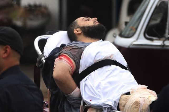 Les images de son arrestation à Linden, dans le New Jersey, diffusées lundi montraient Ahmad Khan Rahami allongé sur un brancard, le bras ensanglanté.